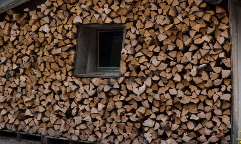 Swiss organisation.  A wall of wooden logs, a sight that never ceases to thrill me!